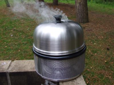 The Cobb Premier Ultimate Barbecue Cooking System.